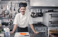 Chef smiling happy posing looking professional, commercial kitch Royalty Free Stock Photo