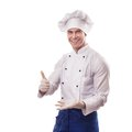 Chef standing on white background with thumbs up Stock Image