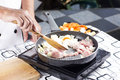 Chef stir-fried slice of pork in the pan for cooking Japanese po Royalty Free Stock Photo