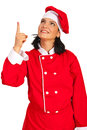 Chef woman pointing up in red uniform to copy space isolated on white background Stock Photography
