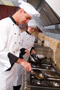 Chefs cooking Stock Photography