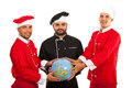 Chefs team holding world globe of three men isolated on white background Stock Photography