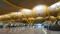 Chek in hall of barajas airport madrid spain april april madrid spain interior terminal designed by antonio lamela and Royalty Free Stock Image