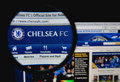 Chelsea fc photo of homepage on a monitor screen through a magnifying glass Royalty Free Stock Photo