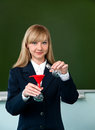 Chemical experience in the classroom teacher is holding a flask Stock Photography