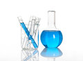 Chemical flask with a blue tubes inside Stock Photo
