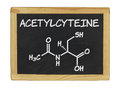 Chemical formula of acetylcysteine on a blackboard Stock Photos