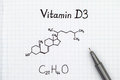 Chemical formula of Vitamin D3 with pen. Royalty Free Stock Photo