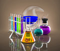 Chemical laboratory various vessels with colored chemicals symbolize science Stock Photography