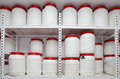 Chemical plastic barrels on shelves in storehouse Royalty Free Stock Photo