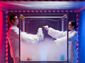 Chemical reactions in sterile chamber two scientists a men and a woman mixing chemicals a labeled as bio hazardous filled with Stock Images