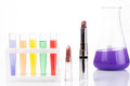 Chemical test tubes and lipstick. harmful Royalty Free Stock Photo