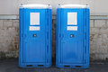 Chemical toilet two portable cabins at construction site Royalty Free Stock Image