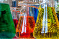 Chemistry bubbles colored solutions with in glassware are meaningful for science and environment or chemical industry Royalty Free Stock Photography
