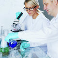 Chemistry scientist conducting experiments in laboratory Royalty Free Stock Images