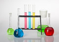 Chemistry set on grey background with test tubes and beakers filled with coloured liquids Stock Photography