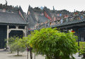 The chen clan ancestral hall trees in yard and colored figures on roof of guangzhou canton china guangdong folk art Royalty Free Stock Images