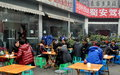 Chengdu china people eating outside at restaurant patrons tables in front of a popular on a cold december day in Royalty Free Stock Photos