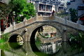 Chengdu china stone bridge at long tan water town a serene three arched spans one of the waterways in Stock Photo