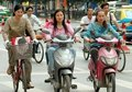 Chengdu, China: Women Riding Mopeds Stock Photos