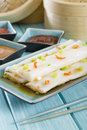 Cheong fun chinese steamed rice rolls with dried shrimp and spring onion served with hoisin sauce soybean paste and chili dip dim Stock Image