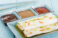 Cheong fun chinese steamed rice rolls with dried shrimp and spring onion served with hoisin sauce soybean paste and chili dip dim Stock Photos