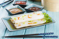Cheong fun chinese steamed rice rolls with dried shrimp and spring onion served with hoisin sauce soybean paste and chili dip dim Royalty Free Stock Photography