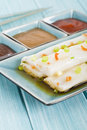 Cheong fun chinese steamed rice rolls with dried shrimp and spring onion served with hoisin sauce soybean paste and chili dip dim Royalty Free Stock Photos