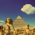 Cheops pyramid and sphinx in Egypt  - vintage retro style Royalty Free Stock Images