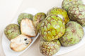 Cherimoya  on plates Royalty Free Stock Photos