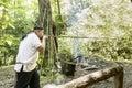 Cherokee using traditional blowgun Royalty Free Stock Photo