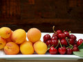 cherries and apricots on a tray Royalty Free Stock Photo