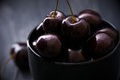 Cherries in black bowl Royalty Free Stock Photo