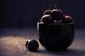Cherries in black bowl Royalty Free Stock Photo