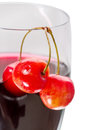 Cherries and cherry juice three a glass of close up Stock Image