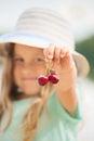 Cherries in child`s hand Royalty Free Stock Photo