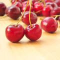 Cherries closeup of some appetizing on a wooden surface Royalty Free Stock Photo