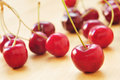 Cherries closeup of some appetizing on a wooden surface Stock Images