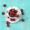 Cherries in cup Royalty Free Stock Photo