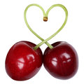Cherries forming a heart love topic Royalty Free Stock Photo