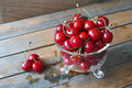 Cherries fresh red in glass bowl against wooden background Royalty Free Stock Photos