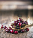 Cherries. Fresh sweet cherries. Delicious cherries with water drops in retro bowl on old oak table Royalty Free Stock Photo