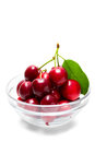 Cherries on glass bowl, on white background Stock Photo