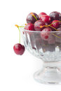 Cherries in glass bowl white background Stock Photo