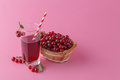 Cherries and a glass of cherry juice on pink background Royalty Free Stock Photo