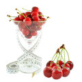 Cherries in a glass and meter on white background Royalty Free Stock Images