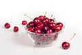 Cherries in glass sweet dish on white Stock Photo