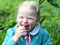 Cherries little blond girl eating in the garden Royalty Free Stock Image