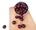 Cherries in loose form and in a bowl Royalty Free Stock Photo