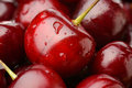 Cherries macro photo of fresh and natural red with water drops Royalty Free Stock Images